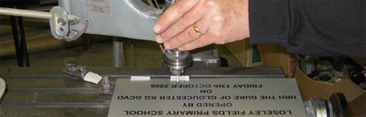 A close-up of one of our engravers working on an engraved plaque
