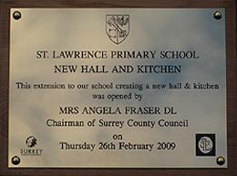brass_school_sign