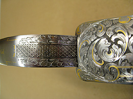 Close-up of James Purdey gun showing engraved trigger guard