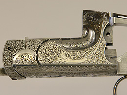 Close up of James Purdey gun with extremely fine detailed engraving