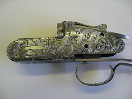 Beatiful gold inlay design on Watson Bros gun