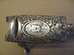 Close-up of engraved Watson Bros gun with gun dog portrait