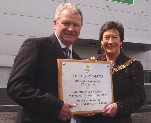 The Mayor of Derby holding a stainless steel presentation plaque manufactured by able engraving