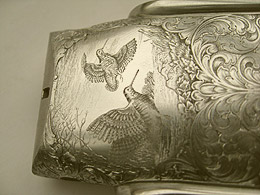 Engraved gun showing beautiful fine detailed engraving