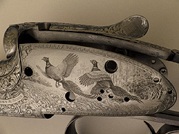 Close-up of engraved gun showing wild fowl design
