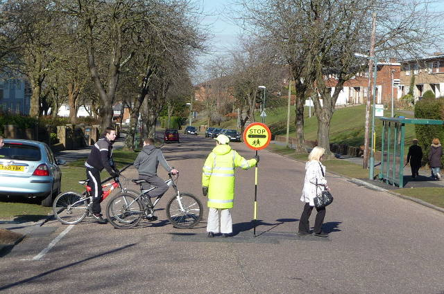 Lollipop Lady, Bournemouth (image by Lewis Clarke). Could laser etching lead to illuminated lollipop signs?