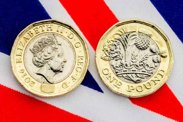 Royal Mint post Pound coin image by Linda Bestwick (via Shutterstock).